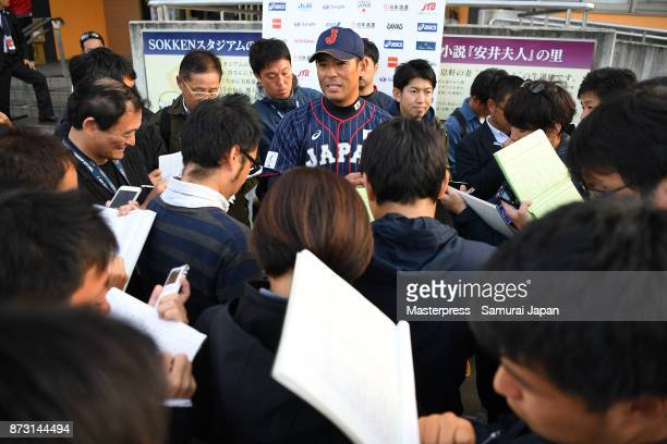 Atsunori Inaba of Samurai Japan looks on during the practice game between Japan and Hokkaido Nippon Ham Fighters at Sokken Stadium on November 12...