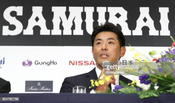Atsunori Inaba the new manager of Japan's national baseball team attends a press conference in Tokyo on July 31 assuming responsibility for winning...