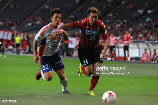 Atsushi Kawata of Albirex Niigata and Akito Fukumori of Consadole Sapporo compete for the ball during the JLeague J1 match between Consadole Sapporo...