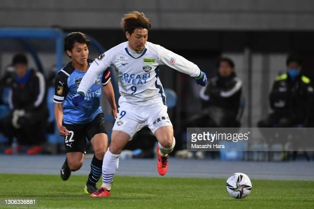 Atsushi Kawata of Tokushima Vortis and Kento Tachibanada of Kawasaki Frontale compete for the ball during the J.League Meiji Yasuda J1 match between...