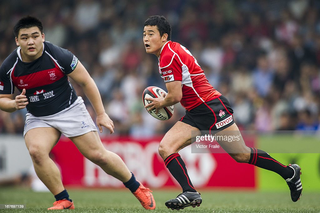 Atsushi Kikutani of Japan moves the ball against Hong Kong during their Asian 5 Nations Top 5 Division match at the Hong Kong Football CLub on April 27, 2013 in Hong Kong, China.