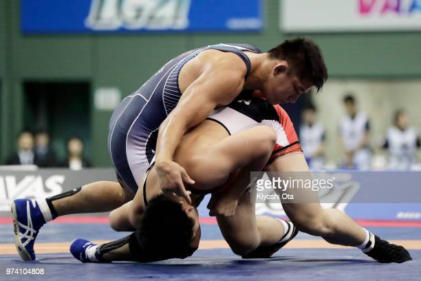 Atsushi Matsumoto competes against Takashi Ishiguro in the Men's Freestyle 92kg final on day one of the All Japan Wrestling Invitational...