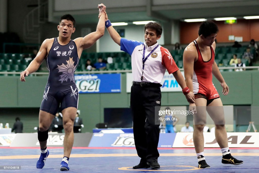 Atsushi Matsumoto (L) reacts after winning the Men's Freestyle 92kg final against Takashi Ishiguro on day one of the All Japan Wrestling Invitational Championships at Komazawa Gymnasium on June 14, 2018 in Tokyo, Japan.
