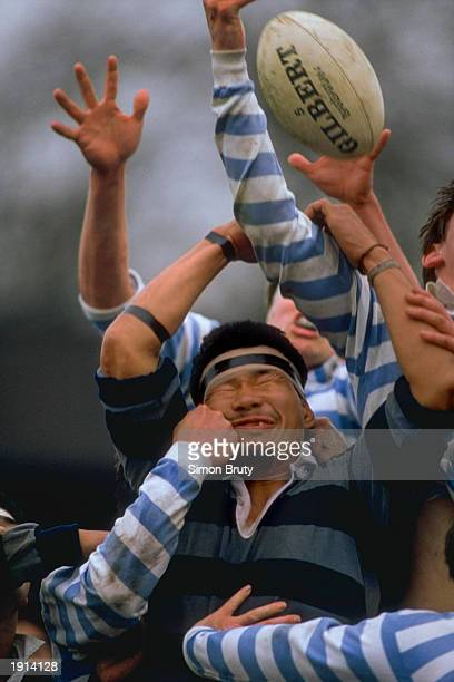 Atsushi Ogagi of Japan suffers in the line out during the friendly match between Cambridge University and the Japanese University of Doshiba in...