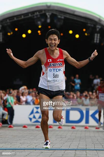 Atsushi Sato of Japan celebrates finishing the men's Marathon Final during day eight of the 12th IAAF World Athletics on August 22 2009 in Berlin...
