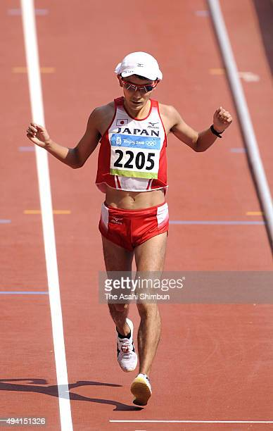 Atsushi Sato of Japan competes in the Men's Marathon held at the National Stadium during day sixteen of the Beijing 2008 Olympic Games on August 24...