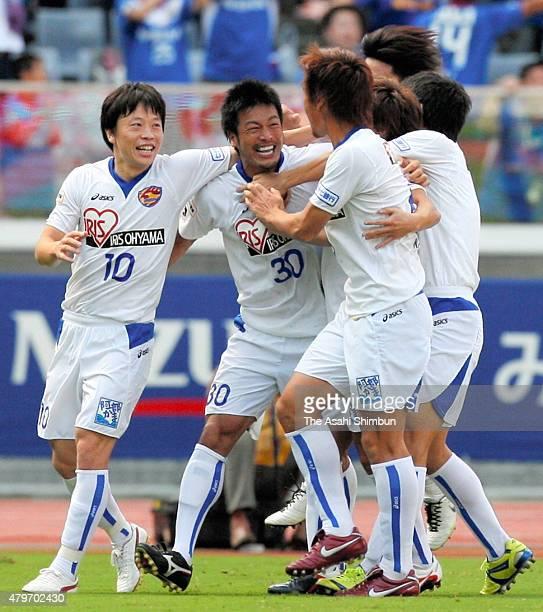 Atsushi Yamagisawa of Vegalta Sendai celebrates scoring his team's second goal with his team mates during the JLeague match between Yokohama FMarinos...
