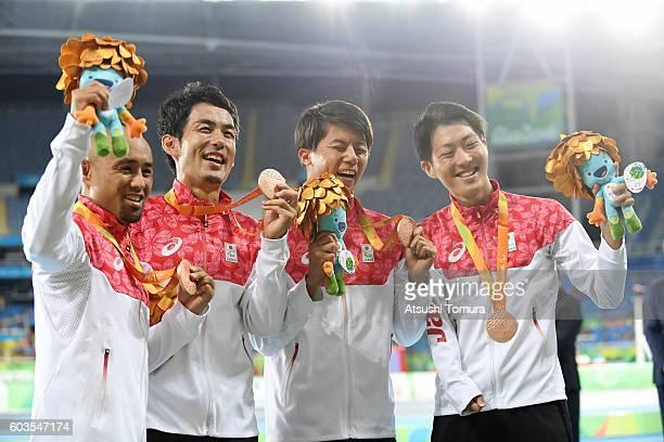 Atsushi Yamamoto Tomoki Tagawa Keita Sato and Hajimu Ashida of Japan celebrate their bronze medal after finishing fourth and disqualification of the...