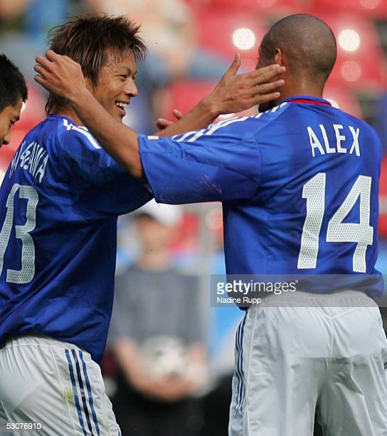 Atsushi Yanagisawa celebrates scoring a goal with Alessandro Santos of Japan during the FIFA Confederations Cup Match between Japan and Mexico at the...