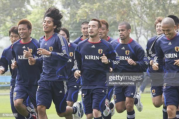 Atsushi Yanagisawa Hidetoshi Nakata Yuji Nakazawa Santos Alessandro and Shinji Ono jog with other members of Japan's national soccer team duing the...