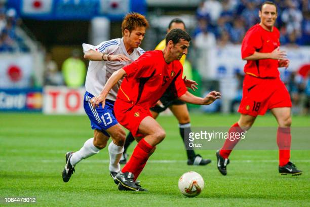 Atsushi Yanagisawa of Japan and Jacky Peeters of Belgium during the World Cup match between Japan and Belgium in Saitama Stadium in Saitama Japan on...