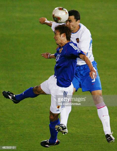 Atsushi Yanagisawa of Japan and Yuri Nikiforov of Russia compete for the ball during the FIFA World Cup Korea/Japan Group H match between Japan and...