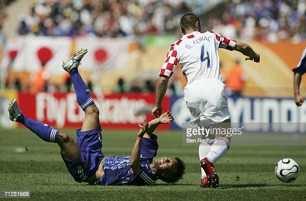 Atsushi Yanagisawa of Japan is brought down by Robert Kovac of Croatia during the FIFA World Cup Germany 2006 Group F match between Japan and Croatia...