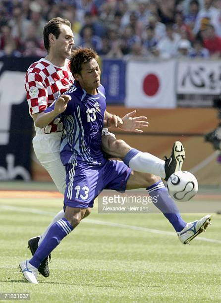 Atsushi Yanagisawa of Japan is tackled by Josip Simunic of Croatia during the FIFA World Cup Germany 2006 Group F match between Japan and Croatia at...