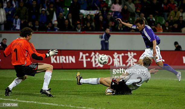 Atsushi Yanagisawa of Japan shoots at goal during the international friendly match between Germany and Japan at the BayArena on May 30 2006 in...