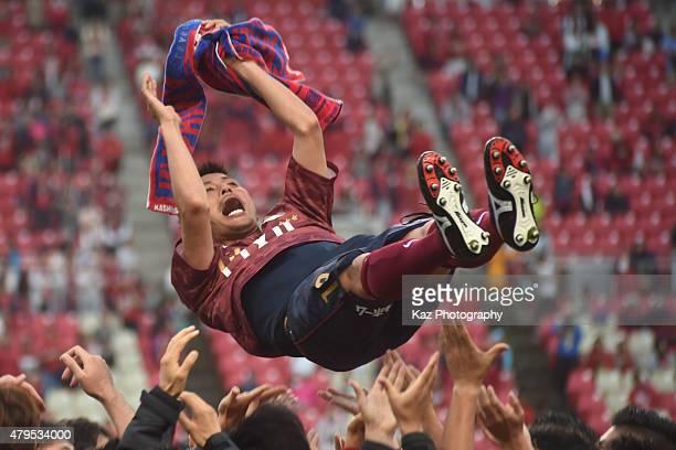 Atsushi Yanagisawa of Kashima Legends being tossed after the J League 2015 retirement game at Kashima Stadium on July 5 2015 in Kashima Japan