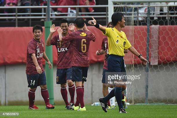 Atsushi Yanagisawa of Kashima Legends celebrates the 1st goal with Koji Nakata of Kashima Legends during the J League 2015 retirement game at Kashima...