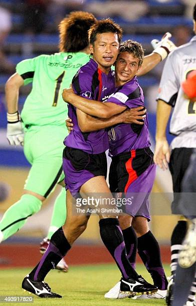 Atsushi Yanagisawa of Kyoto Sanga celebrates scoring his team's first goal with his team mate Fernandinho during the JLeague match between Kyoto...