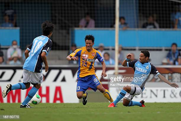 Atsushi Yanagisawa of Vegalta Sendai and Carlinhos Paraiba whose real name is Carlos Pereira Berto Junior of Jubilo Iwata compete for the ball during...