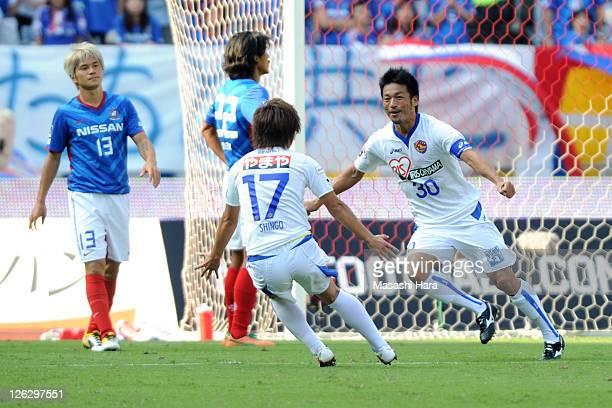 Atsushi Yanagisawa of Vegalta Sendai celebrates their second goal with teammate Shingo Tomita during the JLeague match between Yokohama F Marinos and...