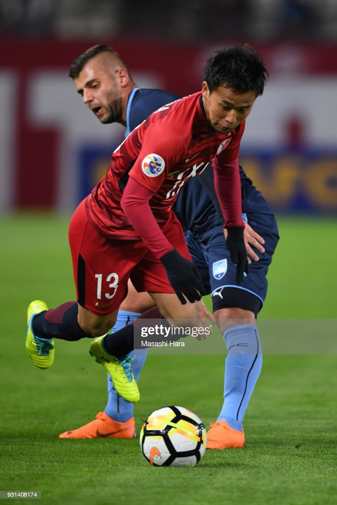 Atsutaka Nakamura of Kashima Antlers and Christopher Zuvela of Sydney FC compete for the ball during the AFC Champions League Group H match between Kashima Antlers and Sydney FC at Kashima Soccer Stadium on March 13, 2018 in Kashima, Ibaraki, Japan.