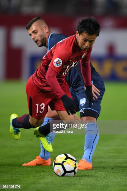 Atsutaka Nakamura of Kashima Antlers and Christopher Zuvela of Sydney FC compete for the ball during the AFC Champions League Group H match between...
