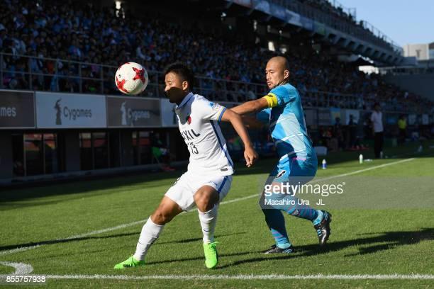 Atsutaka Nakamura of Kashima Antlers controls the ball under pressure of Yutaka Yoshida of Sagan Tosu during the JLeague J1 match between Sagan Tosu...