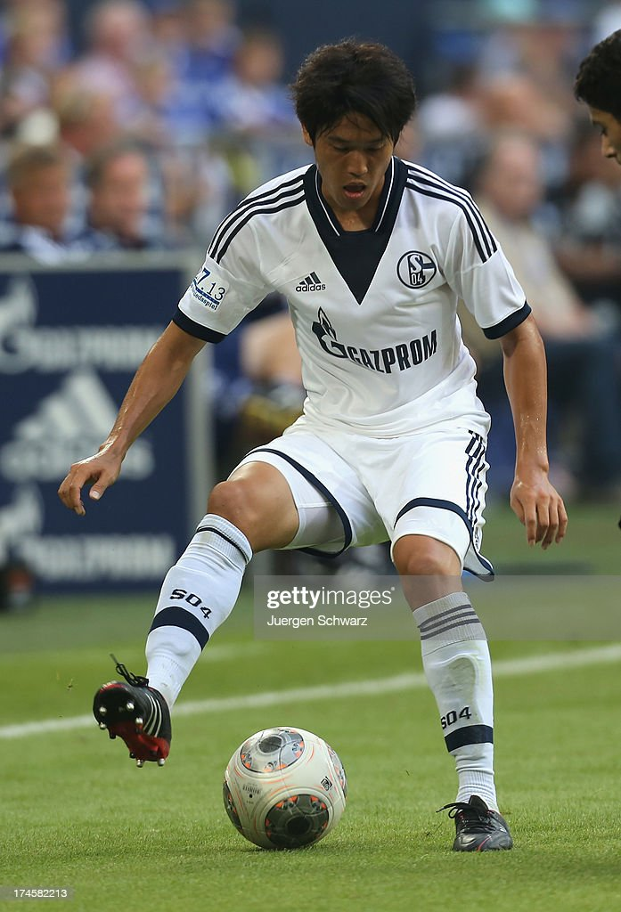 Atsuto Uchida controls the ball during Raul's farewell match between Schalke 04 and Al-Sadd Sports Club Katar at Veltins Arena on July 27, 2013 in Gelsenkirchen, Germany.