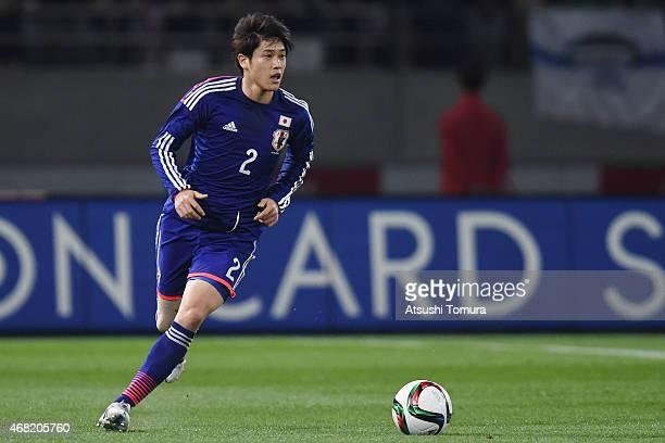 Atsuto Uchida of Japan runs with the ball during the international friendly match between Japan and Uzbekistan at Ajinomoto Stadium on March 31, 2015...