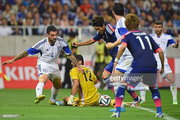 Atsuto Uchida of Japan scores his team's first goal during the Kirin Challenge Cup international friendly match between Japan and Cyprus at Saitama...