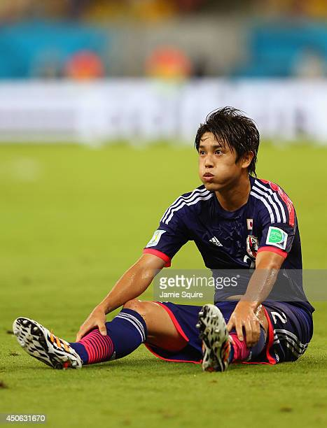 Atsuto Uchida of Japan sits on the field during the 2014 FIFA World Cup Brazil Group C match between the Ivory Coast and Japan at Arena Pernambuco on...
