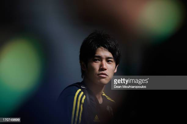 Atsuto Uchida of Japan speaks to the media after the Japan Training Session at the Confederations Cup 2013 at Centro de Capacitacao Fisica dos...