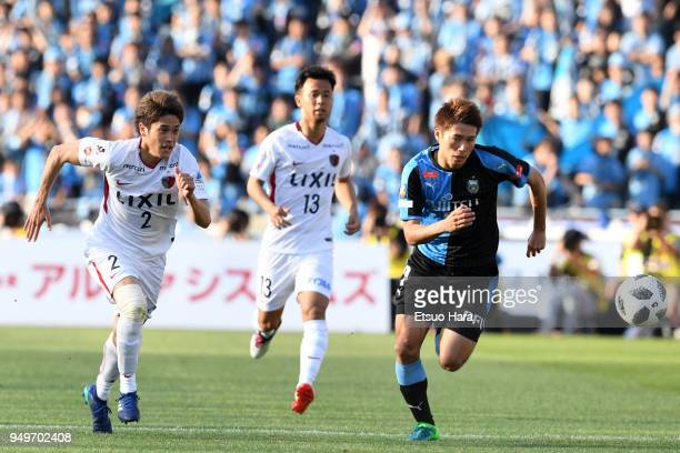 Atsuto Uchida of Kashima Antlers and Shintaro Kurumaya of Kawasaki Frontale compete for the ball during the JLeague J1 match between Kawasaki...