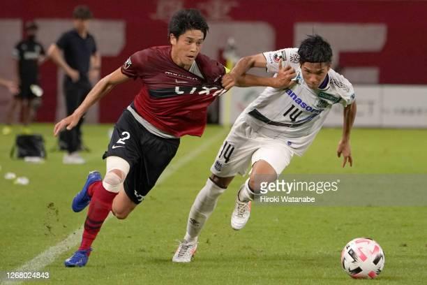 Atsuto Uchida of Kashima Antlers and Yuya Fukuda of Gamba Osaka compete for the ball during the J.League Meiji Yasuda J1 match between Kashima...