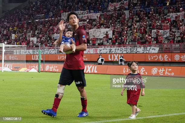 Atsuto Uchida of Kashima Antlers applauds fans during his retirement ceremony after the J.League Meiji Yasuda J1 match between Kashima Antlers and...