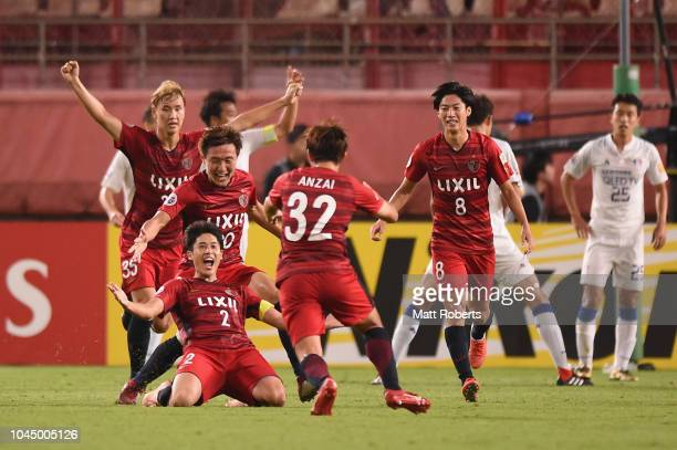 Atsuto Uchida of Kashima Antlers celebrates scoring the winning goal during the AFC Champions League semi final first leg match between Kashima...