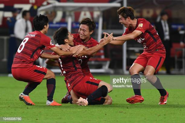 Atsuto Uchida of Kashima Antlers celebrates the third goal during the AFC Champions League semi final first leg match between Kashima Antlers and...