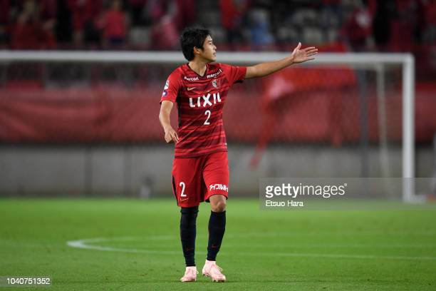 Atsuto Uchida of Kashima Antlers gestures during the 98th Emperor's Cup round of 16 match between Kashima Antlers and Sanfrecce Hiroshima at Kashima...