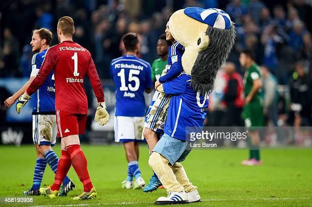 Atsuto Uchida of Schalke 04 celebrates with mascot Erwin after winning the Bundesliga match between FC Schalke 04 and FC Augsburg at Veltins Arena on...