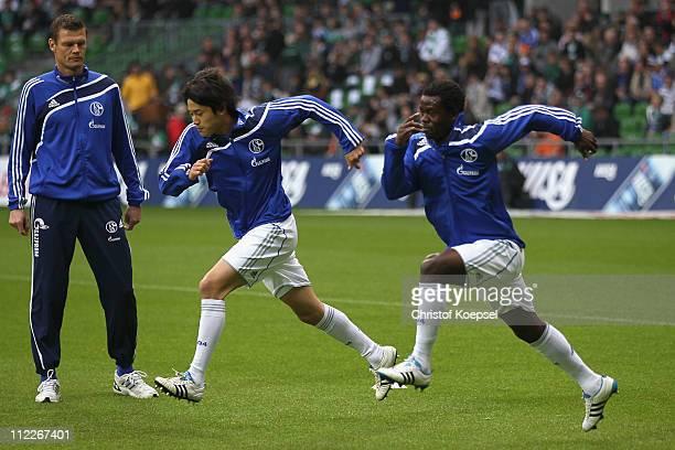 Atsuto Uchida of Schalke and Anthony Annan of Schalke run prior to the Bundesliga match between SV Werder Bremen and FC Schalke 04 at Weser Stadium...