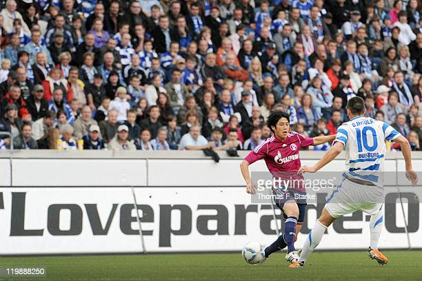 Atsuto Uchida of Schalke and Juergen Gjasula of Duisburg fight for the ball during the Loveparade charity match between MSV Duisburg and FC Schalke...