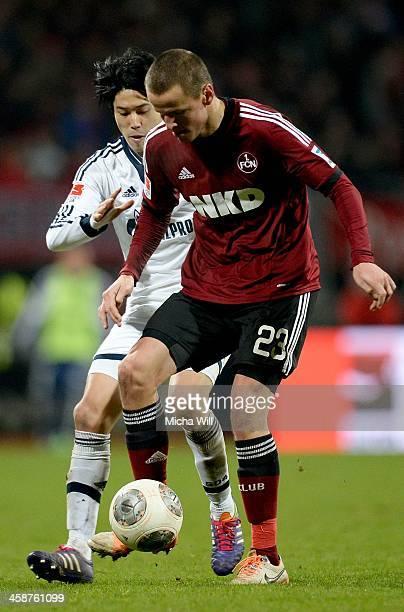 Atsuto Uchida of Schalke challenges Adam Hlousek of Nuernberg during the Bundesliga match between 1 FC Nuernberg and FC Schalke 04 at Grundig Stadium...