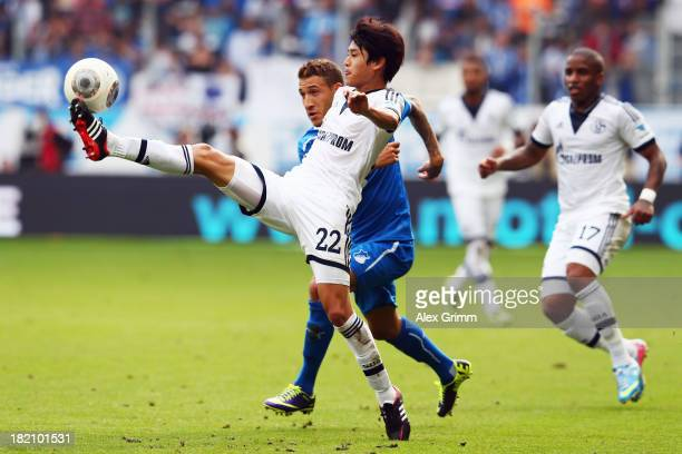 Atsuto Uchida of Schalke is challenged by Fabian Johnson of Hoffenheim during the Bundesliga match between 1899 Hoffenheim and FC Schalke 04 on...
