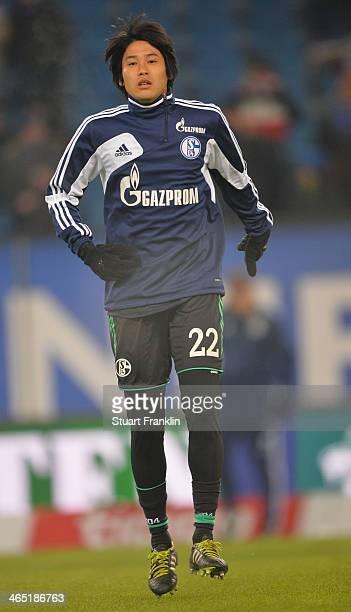 Atsuto Uchida of Schalke warms up before the Bundesliga match between Hamburger SV and FC Schalke 04 at Imtech Arena on January 26 2014 in Hamburg...