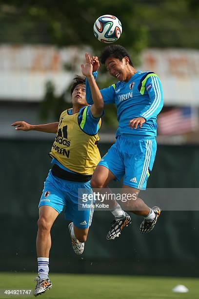 Atsuto Uchida tries to stop Hiroshi Kiyotake from heading a goal during a drill at a Japan training session at North Greenwood Recreation Aquatic...
