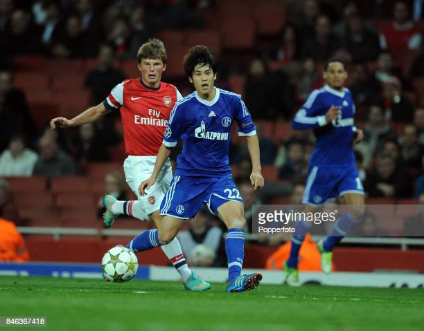 Atsuto Uchina of Schalke and Andrey Arshavin of Arsenal in action during the UEFA Champions League match between Arsenal and FC Schalke at the...