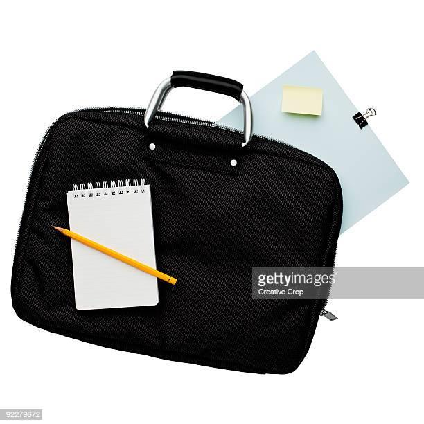Attache case with paper, pad, pencil
