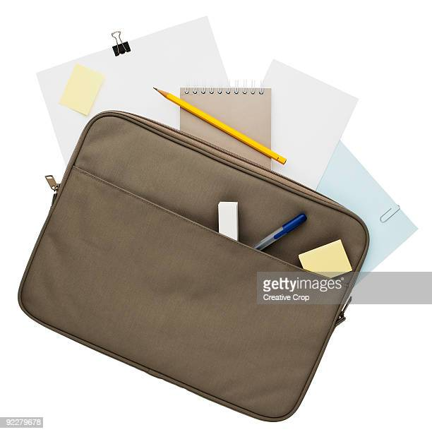 Attache case with pens, pencils, papers, and note