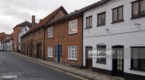 attached houses on a quiet street in a small village - facade stock pictures, royalty-free photos & images