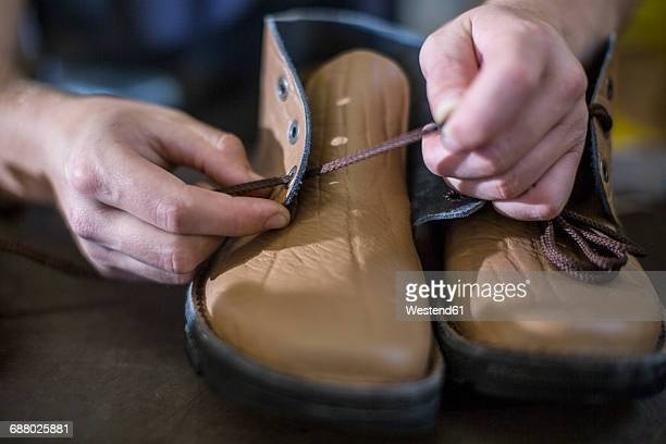 Attaching shoelaces to shoes